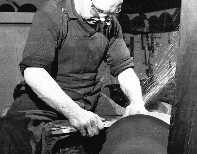 Worker at the grinding wheel