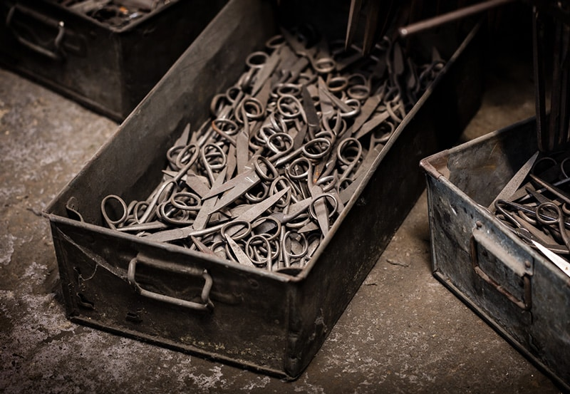 Metal crates full of scissor blanks before being polished and sharpened