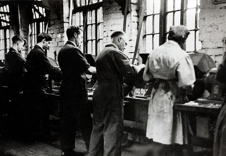 Old photograph of scissor makers working together